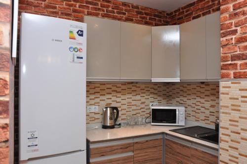 A kitchen or kitchenette at ART Hostel