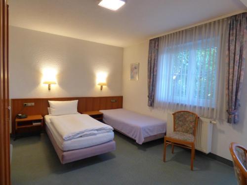Ein Bett oder Betten in einem Zimmer der Unterkunft Pension Meyer