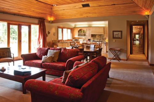 The lounge or bar area at Treetops Lodge & Estate