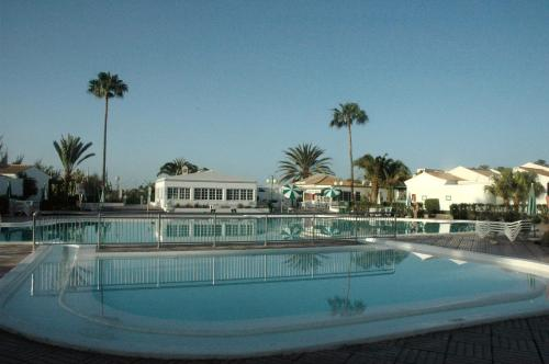 The swimming pool at or near Bungalows Campo Golf