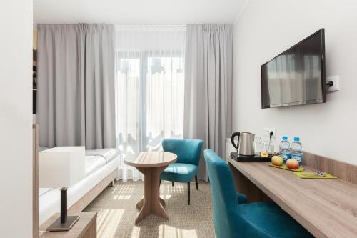 אזור ישיבה ב-Meet Poznań Hotel