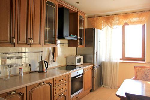 Кухня или мини-кухня в Apartments on Kashirskoye sh, 32к2