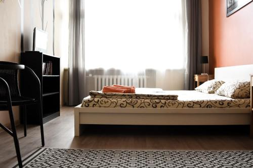 """A bed or beds in a room at R Hostel """"Easy Kaunas"""""""