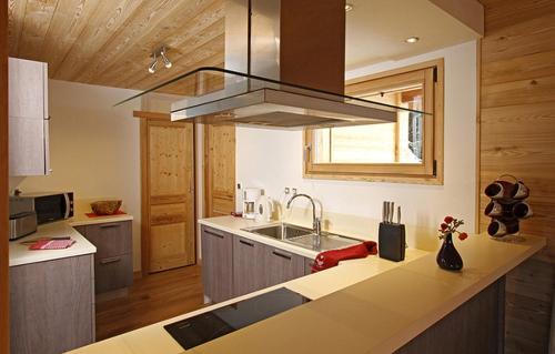 A kitchen or kitchenette at Odalys Chalet La Muzelle