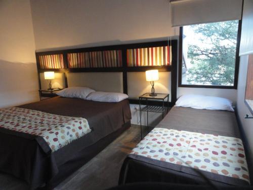 Un ou plusieurs lits dans un hébergement de l'établissement Munay Hotel Cafayate