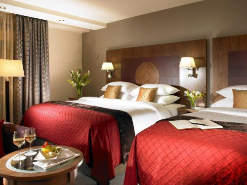 A bed or beds in a room at Westport Plaza Hotel, Spa & Leisure