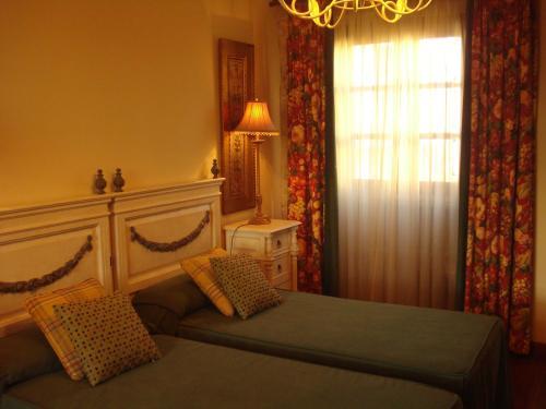 Cama o camas de una habitación en Pazo a Capitana