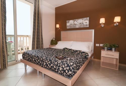 Un ou plusieurs lits dans un hébergement de l'établissement Residence T2