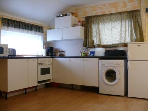 A kitchen or kitchenette at Guesthouse Tonspil