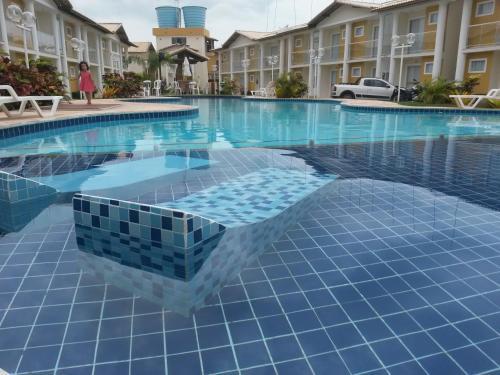 The swimming pool at or near Porto Seguro - BA Apartamento Taperapuan