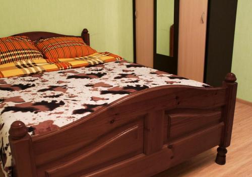 Кровать или кровати в номере Апартаменты на Склизкова 44