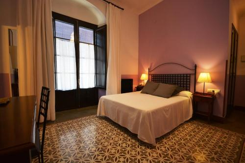 Cama o camas de una habitación en Hotel Casa de los Azulejos