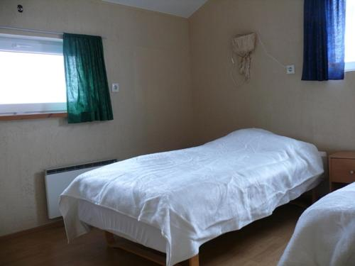 A bed or beds in a room at Guesthouse Tonspil