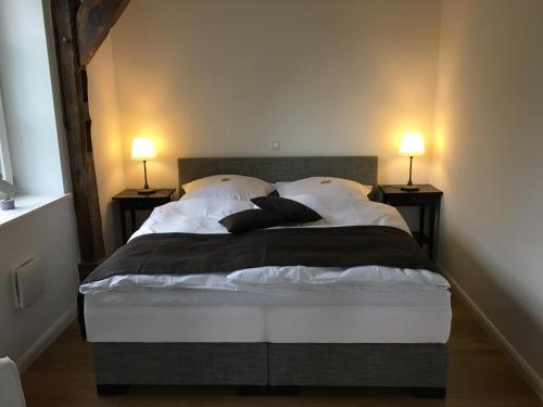 Ein Bett oder Betten in einem Zimmer der Unterkunft Am Deich 13