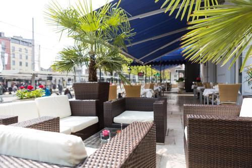 Un restaurante o sitio para comer en Hotel City Inn Basel
