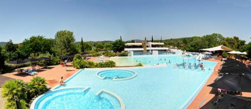 A view of the pool at Camping Village Rocchette or nearby
