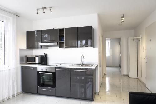 Küche/Küchenzeile in der Unterkunft Design Apartment Metzingen