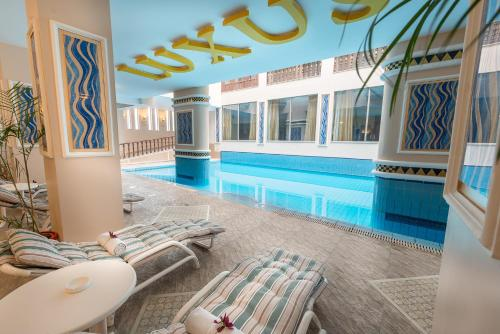 The swimming pool at or close to Luxus Grand Hotel