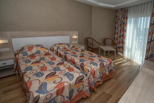 Säng eller sängar i ett rum på Riviera Hotel & Spa