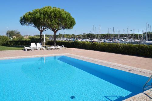 The swimming pool at or near Villa Aprilia with THERMAL SPA POOL