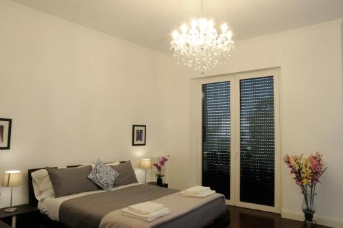 A bed or beds in a room at Montebello Luxury Apartments