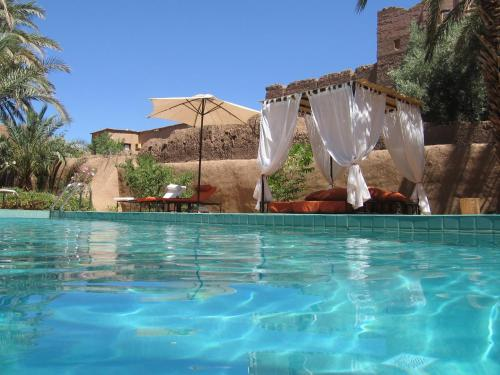 The swimming pool at or near Dar Qamar