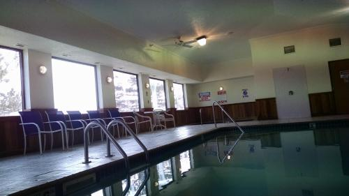 The swimming pool at or near Super 8 by Wyndham Omaha Eppley Airport/Carter Lake
