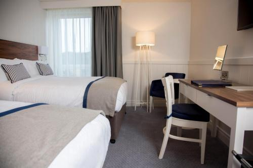 A bed or beds in a room at Waterfront Hotel Dungloe