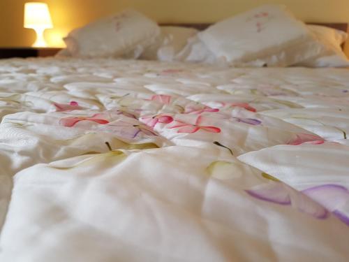 Letto o letti in una camera di Villa Alba