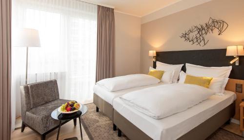 Ein Bett oder Betten in einem Zimmer der Unterkunft Mercure Hotel Koeln Belfortstrasse