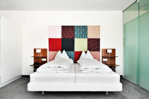 A bed or beds in a room at Casinohotel Velden