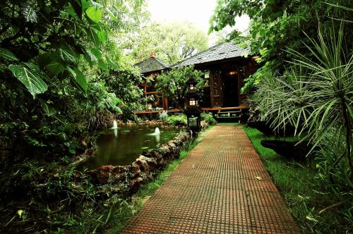 A garden outside The Tree House Resort