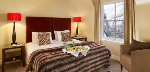 A bed or beds in a room at CLC Duchally Country Estate Hotel & Lodges