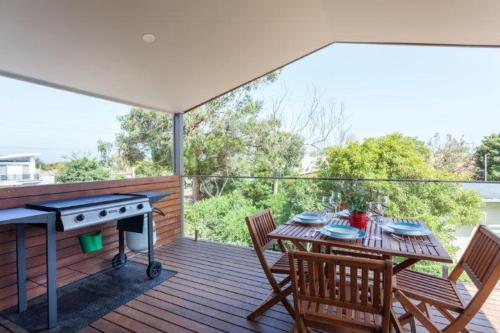 A balcony or terrace at Silversands Beach Cottage
