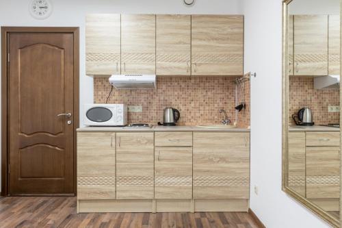 Кухня или мини-кухня в Апартаменты на 8 небе