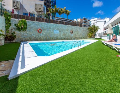 A garden outside Tagoror Beach Apartments