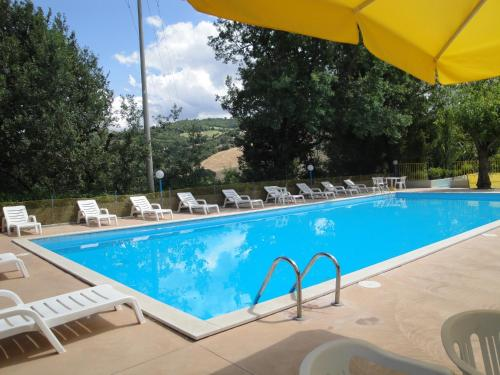 The swimming pool at or near Hotel La Meridiana