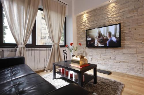 A seating area at Lux Apartments Victoriei