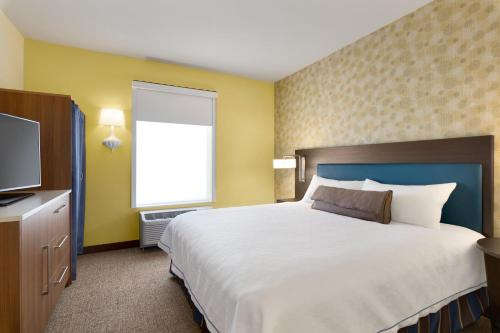 A bed or beds in a room at Home2 Suites By Hilton York