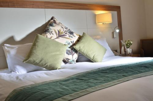 A bed or beds in a room at Newby Bridge Hotel