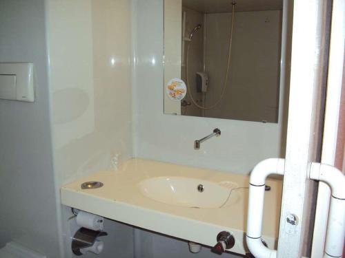 A bathroom at Premiere Classe St Etienne Nord Villars