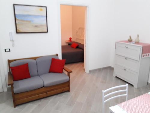 A seating area at Appartamento Mangi