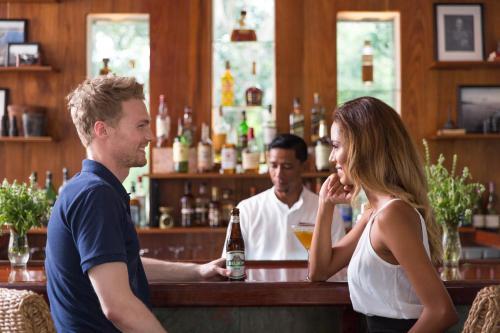 The lounge or bar area at Ka'ana Resort & Spa