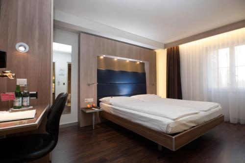 Ein Bett oder Betten in einem Zimmer der Unterkunft Hotel Alexander Zurich Old Town