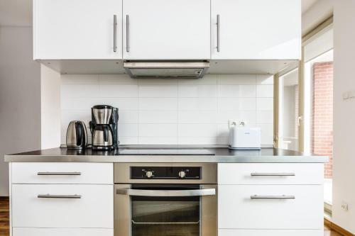 Kuchnia lub aneks kuchenny w obiekcie Home away from home in Gdansk