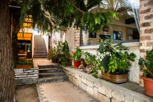 A porch or other outdoor area at DEM Hotel