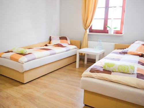 Łóżko lub łóżka w pokoju w obiekcie Hostel Open Tours