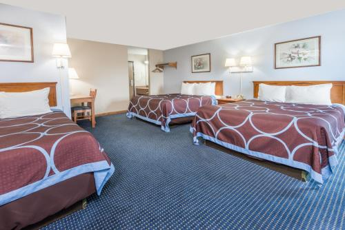 A bed or beds in a room at Super 8 by Wyndham O'Fallon MO/St. Louis Area