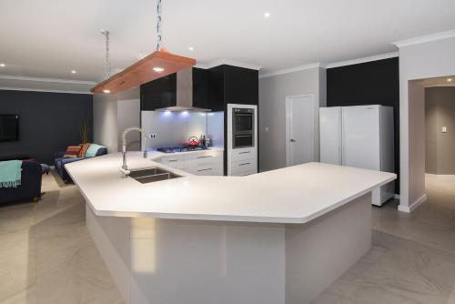 A kitchen or kitchenette at Geographe House