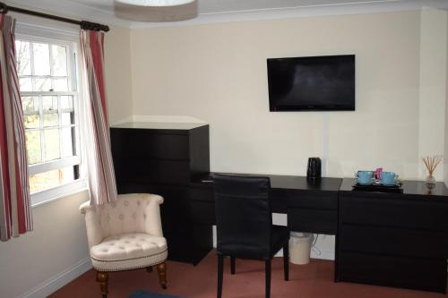 A television and/or entertainment center at The Swan at Great Kimble